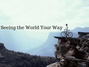 "Picture of man and bike on edge of cliff, with words ""Seeing the World Your Way"""